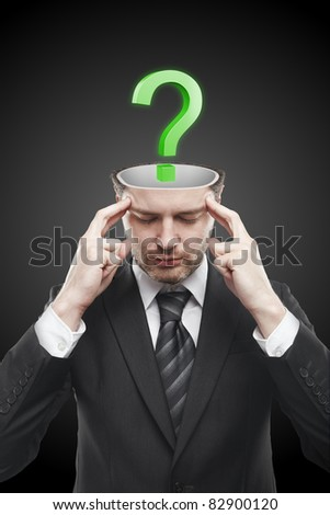 Open minded man with Green question mark inside.Conceptual image of a open minded man. - stock photo