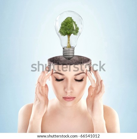 Open minded woman with green energy symbol - stock photo