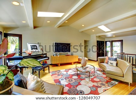 Open modern luxury home interior living room with piano. - stock photo