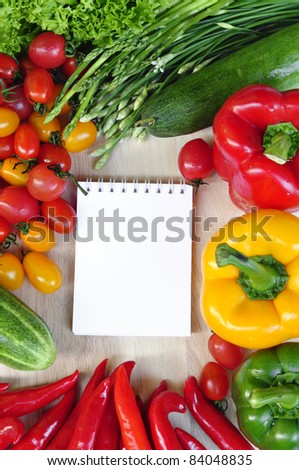 open note book ready with colorful vegetables for writing recipe - stock photo