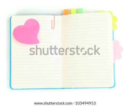 Open note book with stickies isolated on white - stock photo