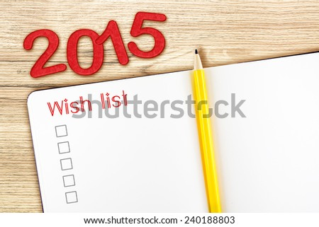 Open notebook and yellow pencil with red 2015 year number and wish list topic on wooden table ,top view, Template mock up for adding your content - stock photo