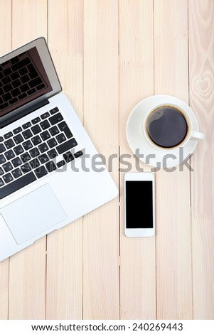 Open notebook, digital tablet, diary, smart phone and a cup of coffee on wooden background, top view - stock photo