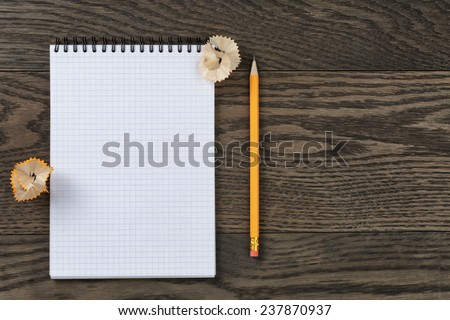 open notebook for writing or drawing on oak table, copy space for something - stock photo