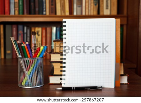 open notebook on the table with office stationery with space for text - stock photo