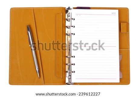 open notebook with a pen on isolated background - stock photo