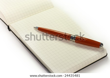 open notebook with a red pen - stock photo