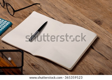 Open notebook with pen on the office table. Top view with copy space. Office workplace - stock photo