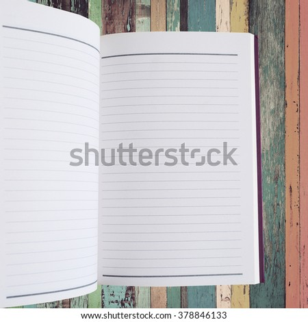 Open notebook with vintage background - stock photo