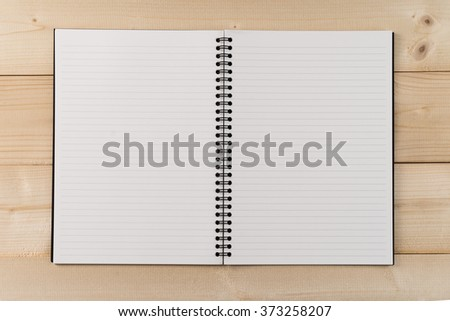 Open notebook with white lined pages on wooden office desk .Top View - stock photo