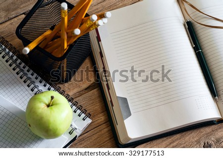 Open notepad with clean pages closeup on office desk. Top view - stock photo