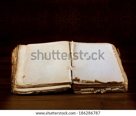 Open old book with blank pages for text on vintage wooden table - stock photo