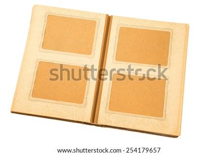 Open old photo album on white background. - stock photo