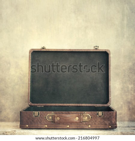 Open old suitcase - stock photo