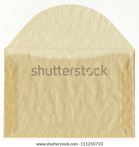 Open Old Used Vintage Glassine Envelope to store stamps, pictures etc. isolated on white background (from very thin and smooth paper that is air and water resistant). - stock photo