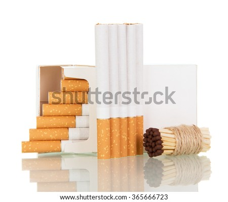 Open pack of cigarettes and a bunch of matches close up isolated on white background - stock photo