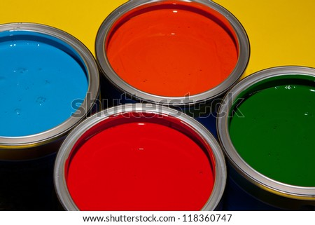 open paint cans /bucket with vivid colors for home improvement - stock photo