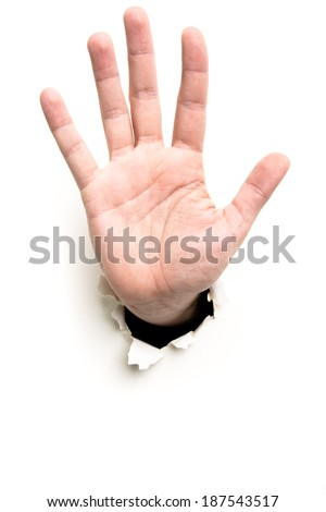 open palm through the paper hole isolated on white background - stock photo