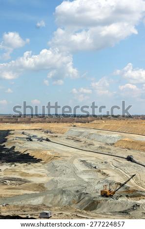 open pit coal mine with excavator industry - stock photo