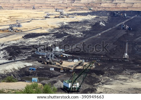 open pit coal mine with machinery and excavators mining industry - stock photo