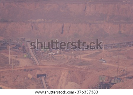 Open pit lignite mine at mae-moh behind the fog, Lampang Thailand - stock photo