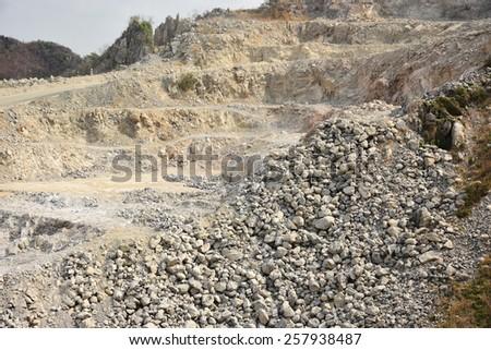 Open-pit limestone mining, Cambodia. - stock photo