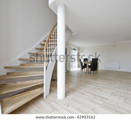 open plan living room of a duplex apartment with staircase - stock photo
