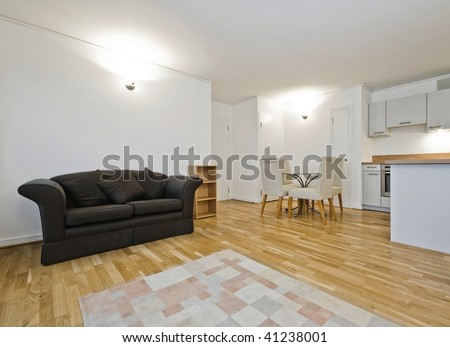 open plan living room with dining table and kitchen counter - stock photo