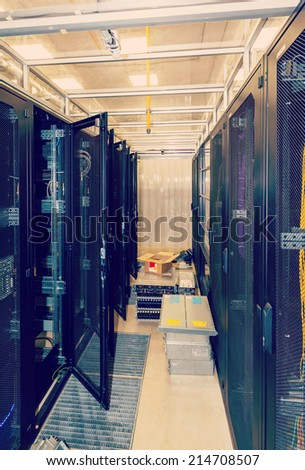 open racks in the data center, the cold aisle and equipment on the floor - stock photo