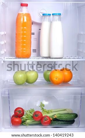 Open refrigerator with vegetarian (diet) food - stock photo
