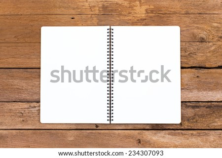 Open ring binder book on wood background - stock photo