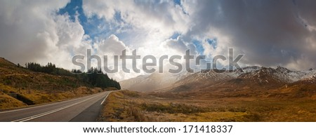 Open road leading through the dramatic Scottish Highlands of Glen Coe, Scotland. - stock photo
