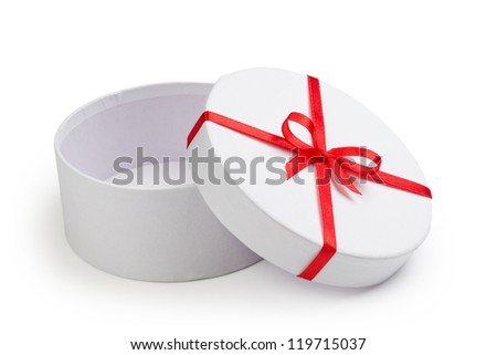 open round gift box with red bow isolated on white - stock photo