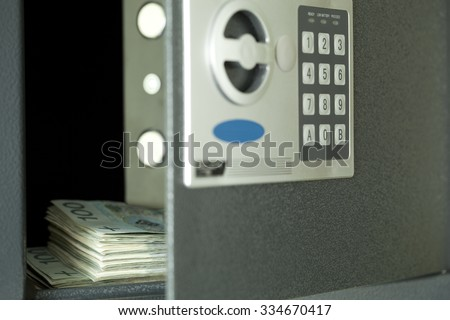 open safe,and in centre hundred Polish money  - stock photo