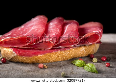 Open sandwich, bread with smoked beef meat slices - stock photo
