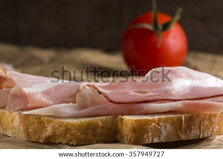 Open sandwich with pork ham over paper - stock photo