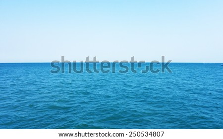 open sea and blue sky - stock photo