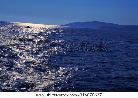 Open sea in windy weather. View from the vessel, intentionally crooked.  - stock photo