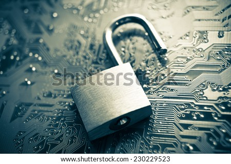 open security lock on computer circuit board - computer security concept - stock photo