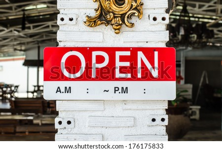 open sign hanging on a pole outside a restaurant, store, office or other - stock photo