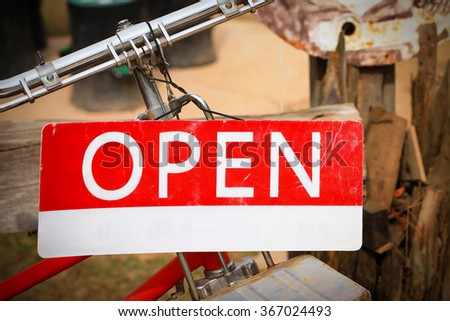 Open sign in street cafe business sign Old style - stock photo
