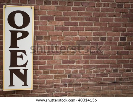 Open Sign on Brick Wall - stock photo