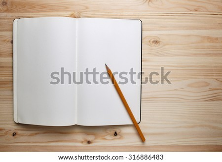 Open Sketchbook or Notebook with Pencil on  Wooden Table. - stock photo
