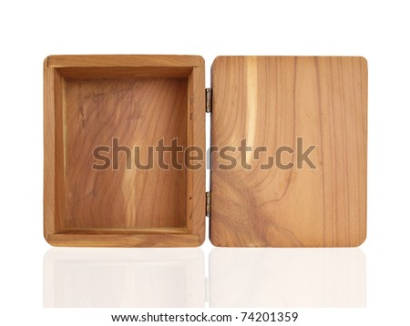 Open small cedar box with hinged lid - stock photo