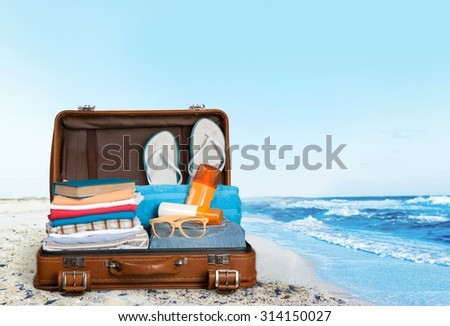 Open suitcase. - stock photo