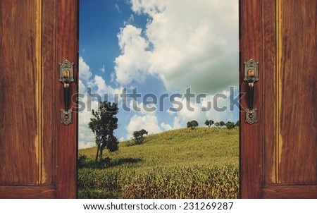 open the door and go out into the nature - stock photo