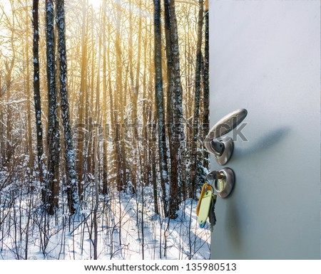 Open the door handle and keys conservatory overlooking the forest and the sun - stock photo