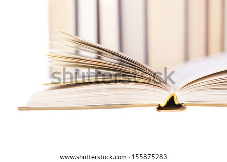 open, the old book against a stack of books - stock photo