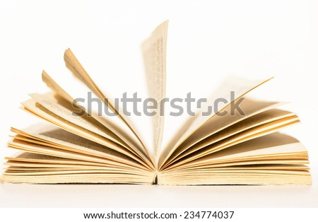 Open the old book and reading it - stock photo