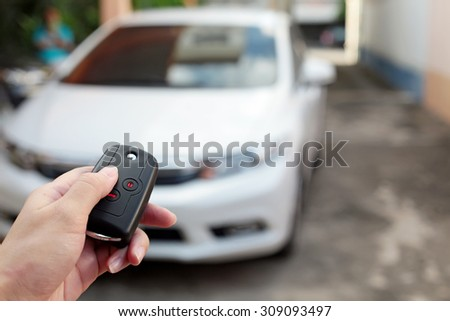 Open the white car on Interlligent key system.  - stock photo